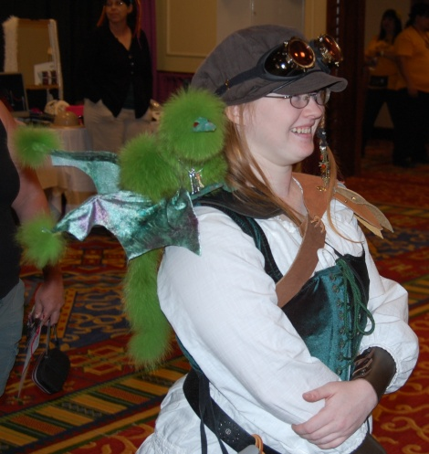 Steampunk cosplayer and pet dragon
